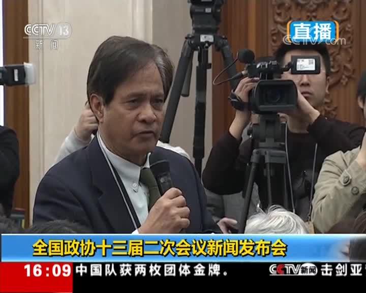 美国全国广播公司记者向郭卫民提问